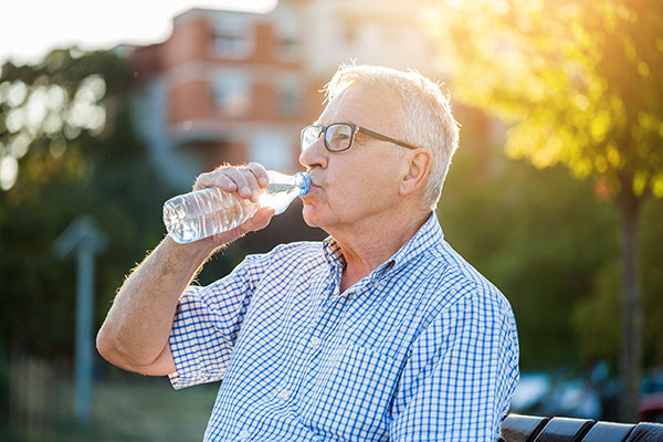 Man drinking water from a bottle