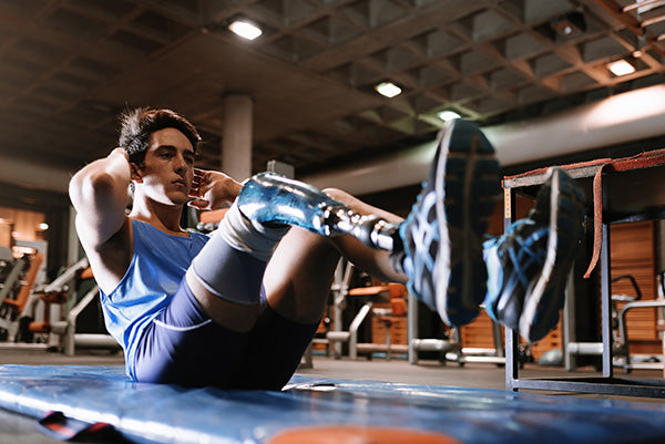 Man doing crunches at gym