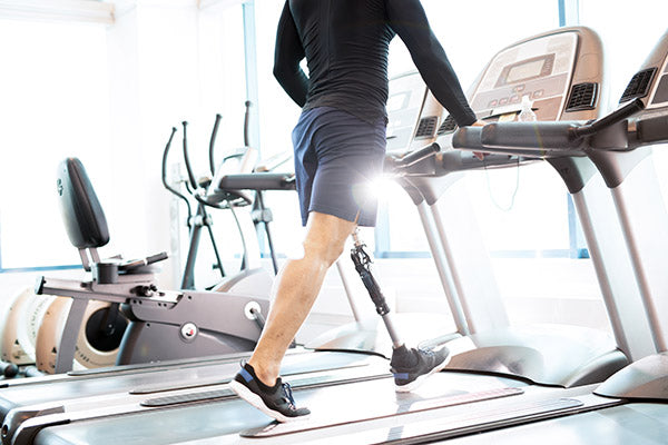 Man with limb loss working out on a treadmill