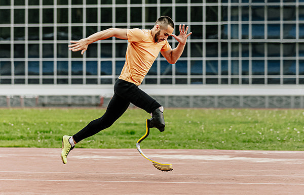Man running with prosthesis
