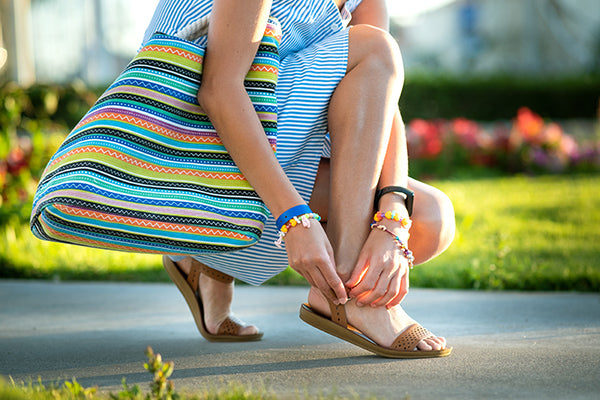 Woman with open toed shoes.