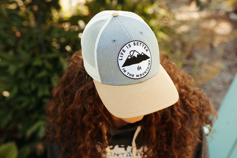 """Life is Better in the Mountains"" Trucker Hat"