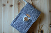 Circular knitting needle organizer with many pockets and notion pouch for lots of needle sets