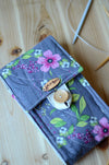 Knitting needle organizer for circular knitting needle set with zipper pocket