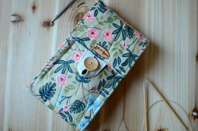 Circular knitting needle storage in mustard flower with many pockets and zipper notion pocket