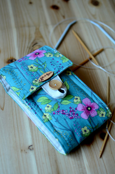 Circualr knitting needle case in teel flower lots of pockets and zipper pocket