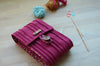 circular knitting needle case with lots and lots of pockets