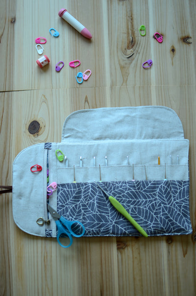 Crochet hook storage in natural linen with a built-in zipper pocket