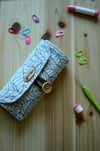 Crochet hook rollup in natural linen with a notion pocket
