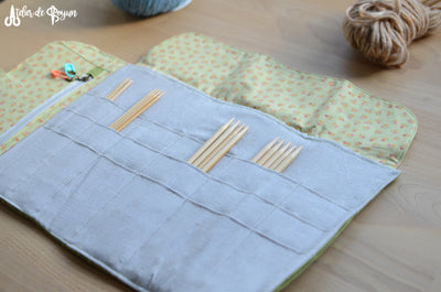 knitting needle organizer with a zipper pocket