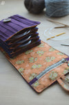 knitting needle orgnization idea for circular needles. lots of pockets and a zipper pocket