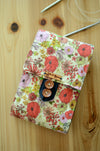 Circular knitting needle storage in colorful print on linen