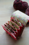 Interchangeable knitting needle case w/lots of pockets