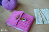 knitting needle holder with lots of pockets