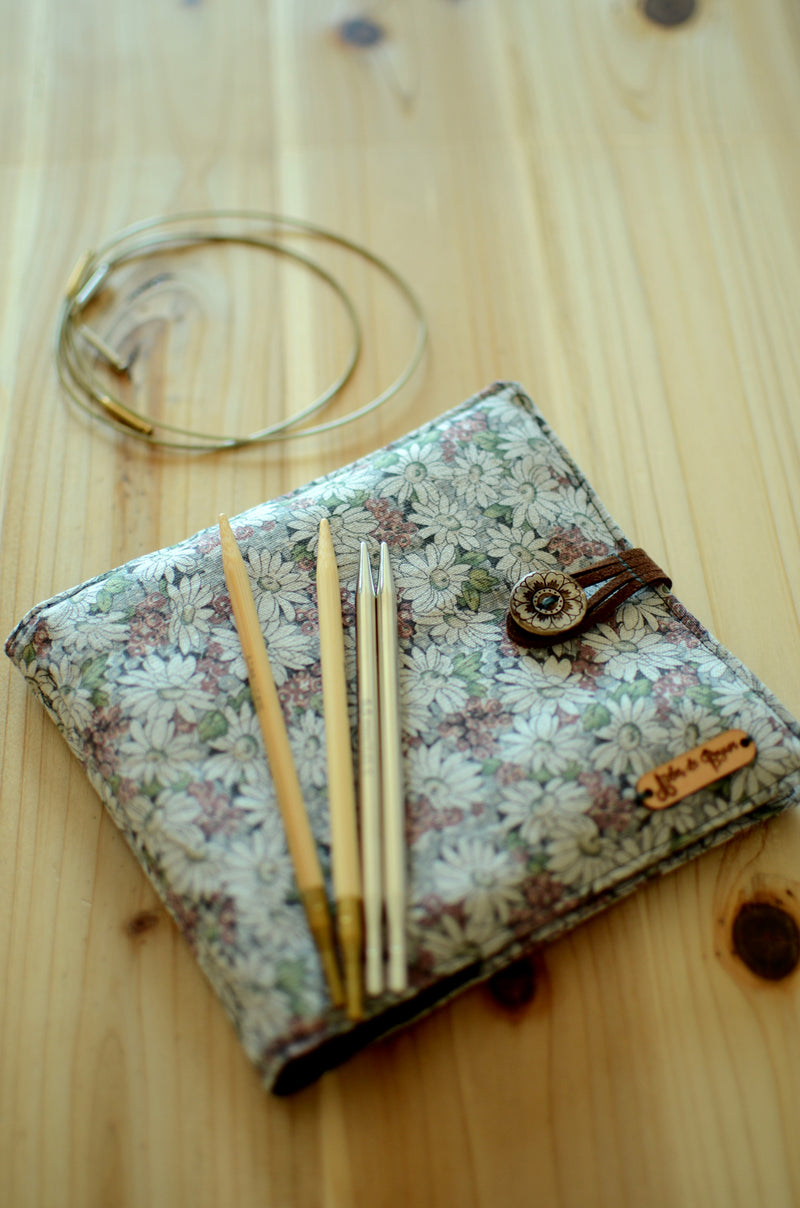 Interchangeable knitting needle case for more than a full ...