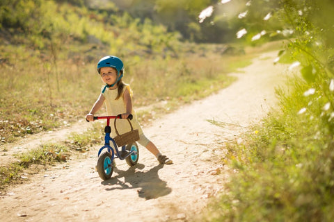 Small child riding a bike