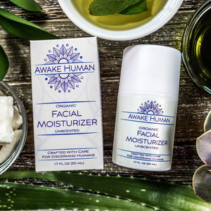 Awake Human Organic Facial Moisturizer unscented with shea butter oils and aloe vera displayed on table