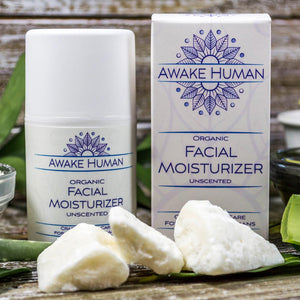 Awake Human Organic Facial Moisturizer unscented on table display with box and shea butter