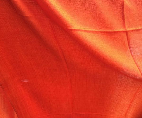 Tangerine orange AUTHENTIC pashmina shawl by Ethical Cashmere, shown flashing bright orange under sunlight