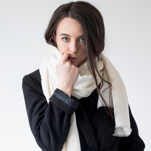 Model wearing the cream AUTHENTIC cashmere pashmina scarf by Ethical Cashmere