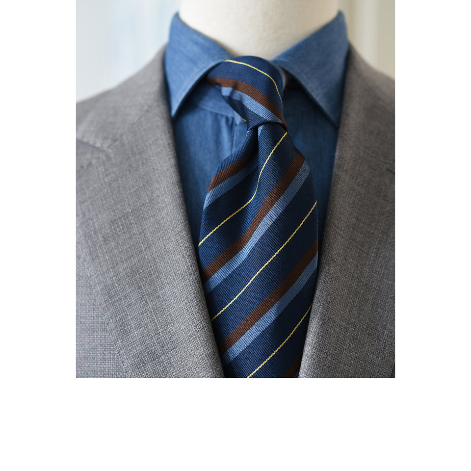 Amidé Hadelin | Regimental silk repp tie - navy/blue/brown/yellow_styled