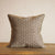 Cotton mix cushion with brown exotic geometrical pattern