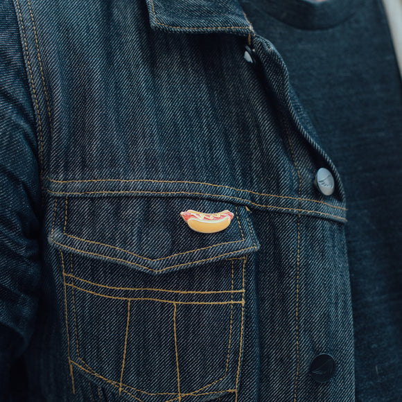 Hotdog Enamel Pin on Denim