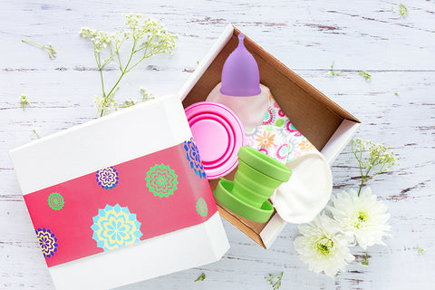Menstrual cup and cloth pad in a box for blog