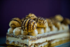 Iced cakes made in Calgary, in-house, by pastry chef Yann Blanchard and Team, with friendly hazelnuts.