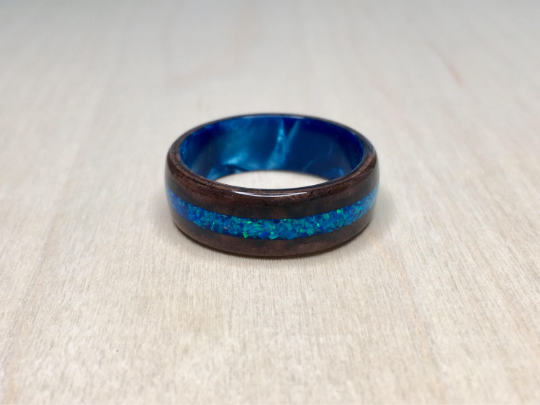 Walnut Burl with Blue Opal on a Light Blue Epoxy Core Ring