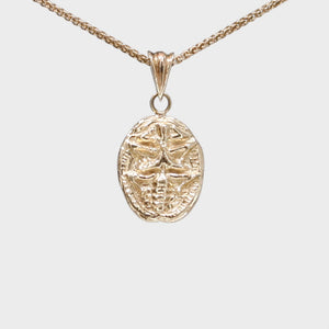 9k Gold Scarab Necklace with Diamond Eyes