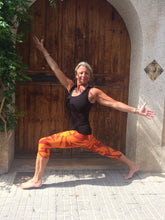 Load image into Gallery viewer, Orange Star Tie Dye Capri Leggings