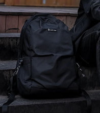 Load image into Gallery viewer, Theo's All-Black Backpack - Packing the essentials