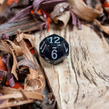D12 dice, black marble with sapphire blue acrylic through middle