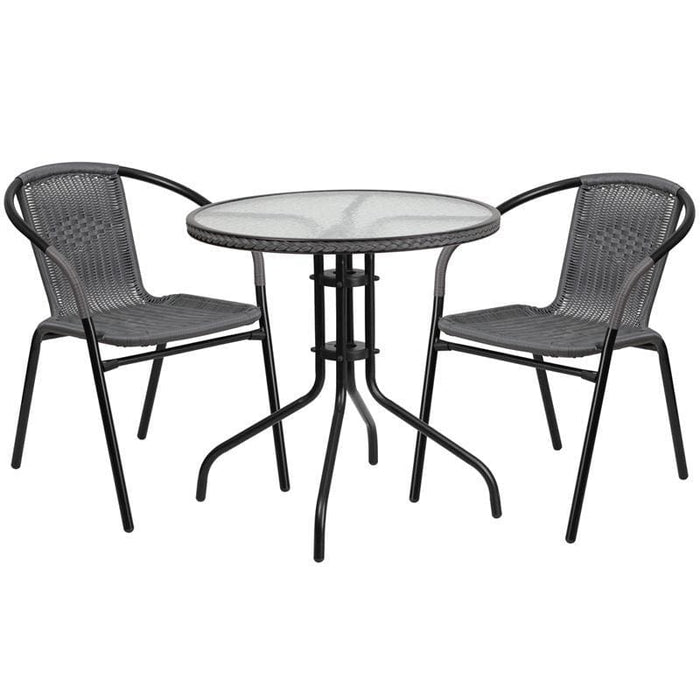 28 Round Glass Metal Table With Gray Rattan Edging And 2 Gray Rattan Stack Chairs - Indoor Outdoor Sets