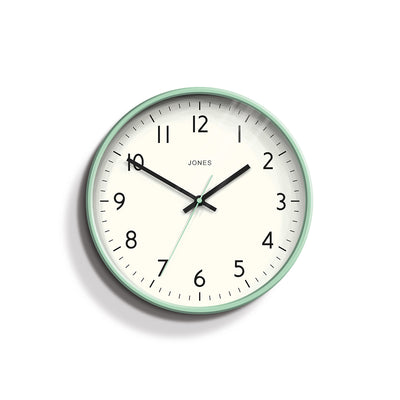 Studio wall clock in Neo-Mint by Jones Clocks with an Arabic dial and straight metal hands