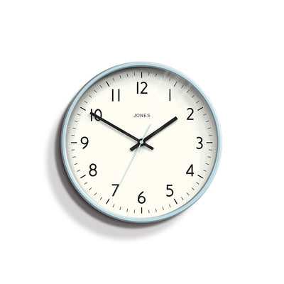 Studio wall clock in Clear Blue by Jones Clocks with an Arabic dial and straight metal hands