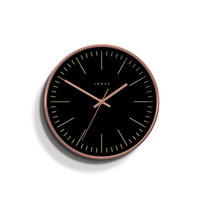 Modern Studio wall clock by Jones Clocks in a copper effect with a reverse black marker dial and copper hands