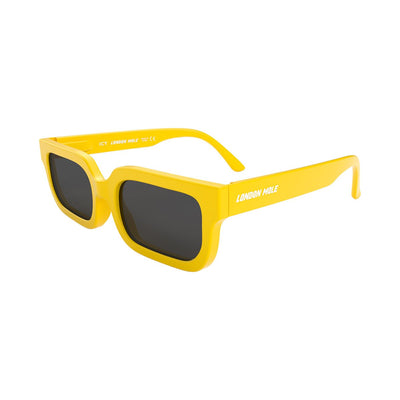 London Mole Icy sunglasses in yellow with black lenses - open and skew
