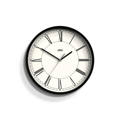 Jones Clocks Spartacus wall clock in black with a modern Roman Numeral dial and straight hands