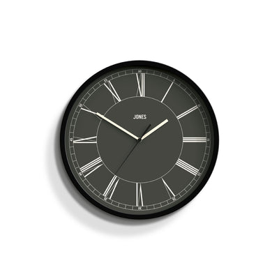 Jones Clocks Spartacus wall clock in black with a modern reverse Roman Numeral dial and straight hands