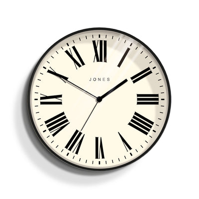 Jones Clocks Magazine wall clock in black with a modern Roman numeral dial - JMAG444K
