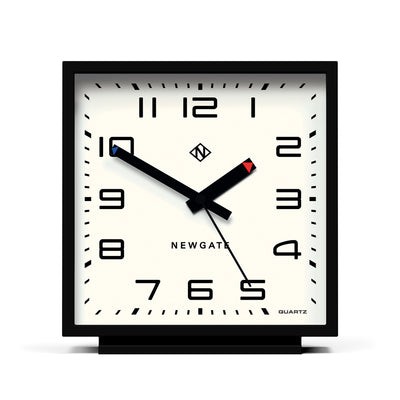 Square shaped Amp mantel clock by Newgate World with a black silicone case and Arabic dial