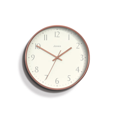 Jones clocks modern Penny wall clock in copper effect with an Arabic dial and straight metal hands