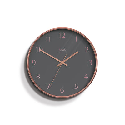 Jones clocks modern Penny wall clock in a copper effect with a grey Arabic dial and straight metal hands