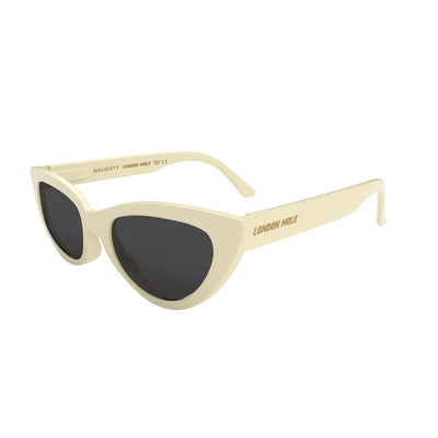 Side skew view of the London Mole Naughty sunglasses in cream with black lenses