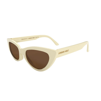 Skew side view of the cream London Mole naughty sunglasses with tan lenses