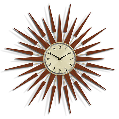 Pluto sunburst style wall clock by Newgate World with dark wood rays and a gold metal Arabic dial