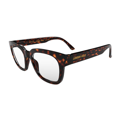 Open skew view of the London Mole Tricky Blue Blocker Glasses in Tortoise Shell