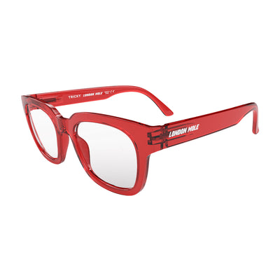 Open skew view of the London Mole Tricky Blue Blocker Glasses in Transparent Red